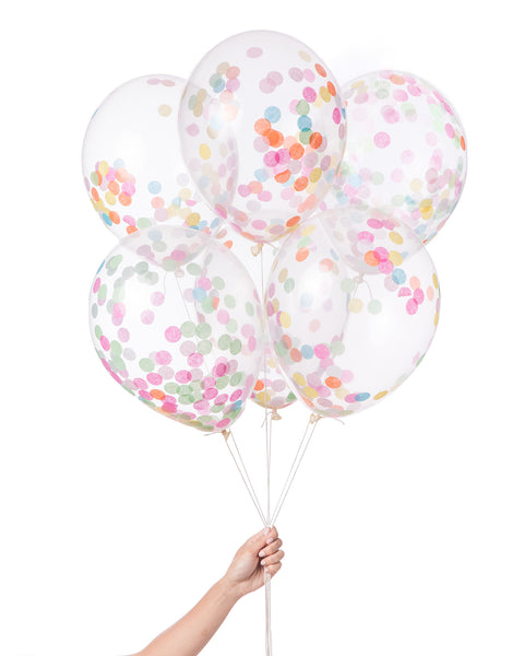 Bunch of clear balloons filled with round confetti in assorted colors