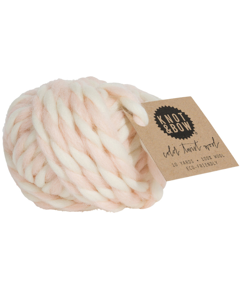 Ball of 10 yards of color twist wool in natural and blush pink colors
