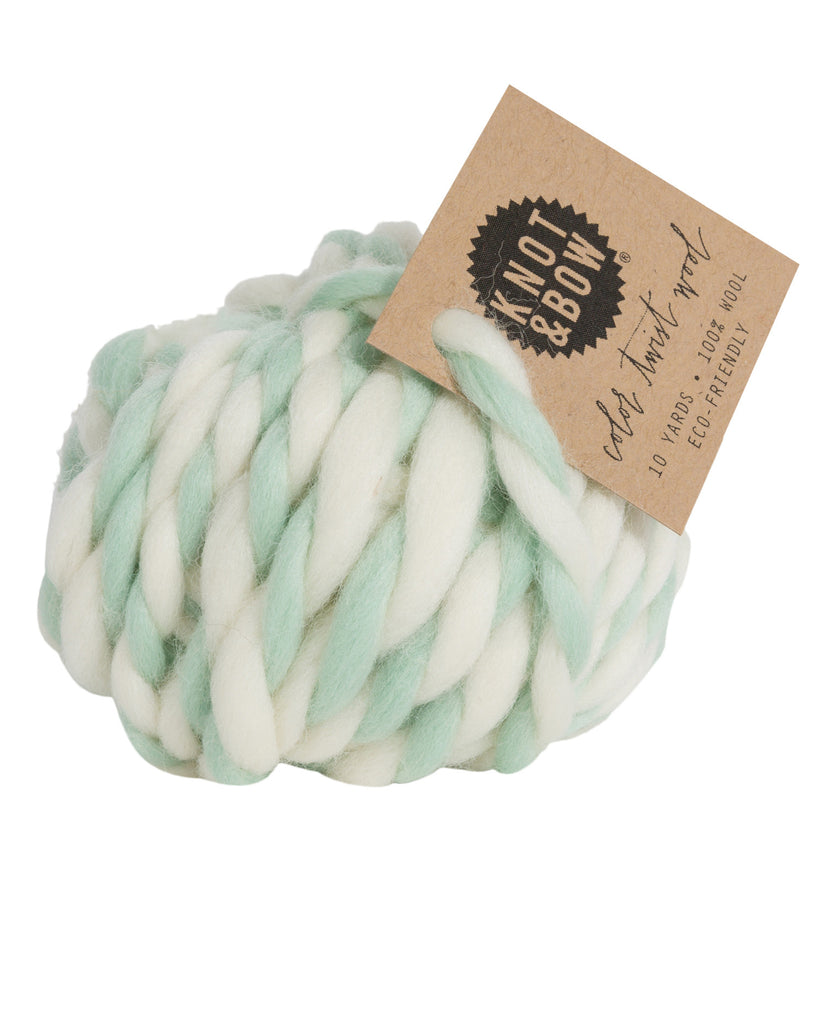 Ball of 10 yards of color twist wool in natural and mint green colors