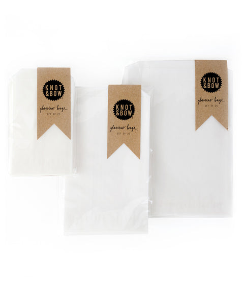 Packages of white glassine bags in small, medium, and large.