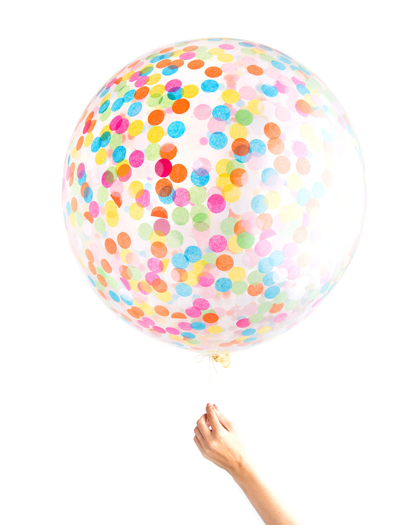 Clear jumbo balloon filled with assorted rainbow circle confetti.