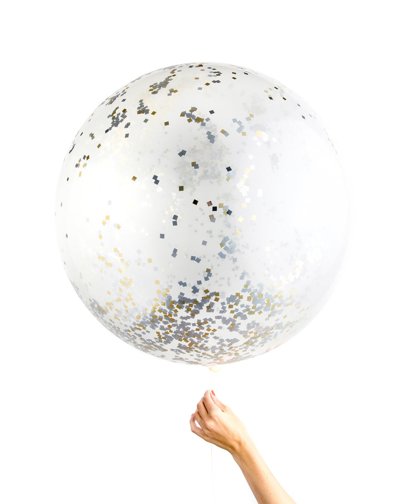 Clear jumbo balloon filled with a mix of white and gold metallic confetti.