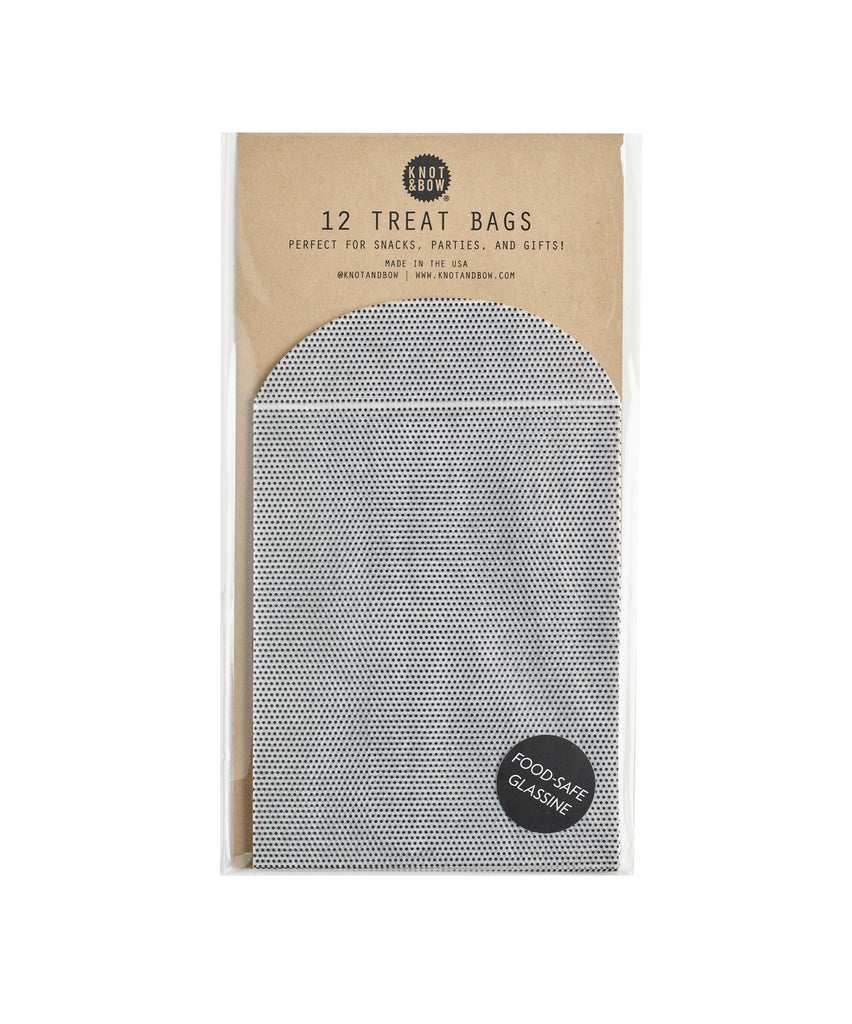 Pack of 12 black and white glassine treat bags with tiny dot pattern.
