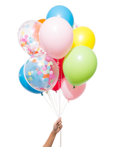 Bunch of party balloons in a mix of rainbow colors and clear balloons filled with assorted confetti