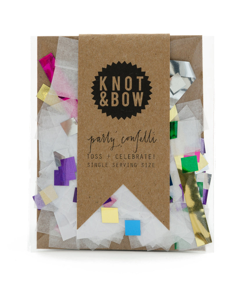 Single serving size of party confetti in a mix of white and rainbow metallic colors in different shapes.
