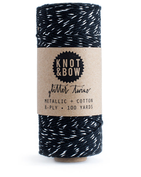 Spool of 100 yards of the original glitter twine in black cotton with a twist of metallic silver