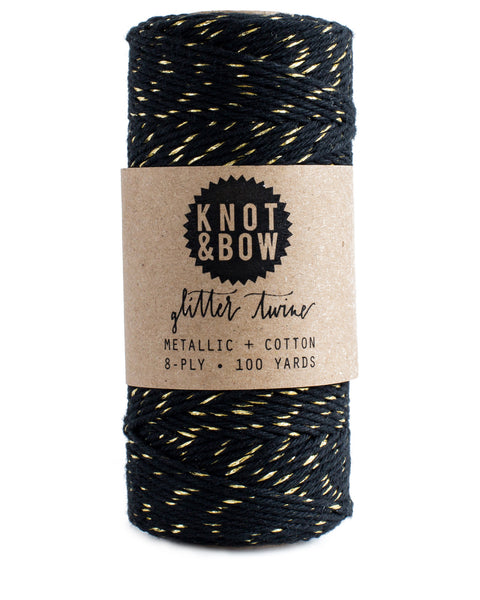 Spool of 100 yards of the original glitter twine in black cotton with a twist of metallic gold