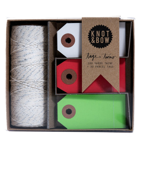 Set of 30 parcel tags in Holiday shades and 100 feet of cotton glitter twine with a twist of silver.
