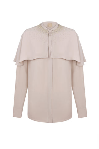 Beige blouse with decoration