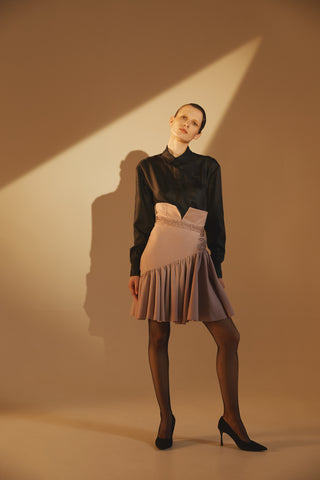 Asymmetric skirt with ruffles