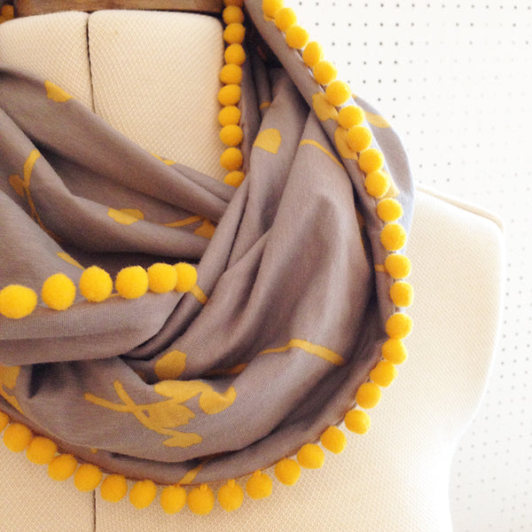 Jersey knit pompom infinity scarf at Fabric HQ