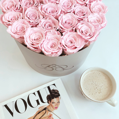 Bling Blooms| Infinity Roses | Genevieve box filled with pink one year roses | vogue book and coffee