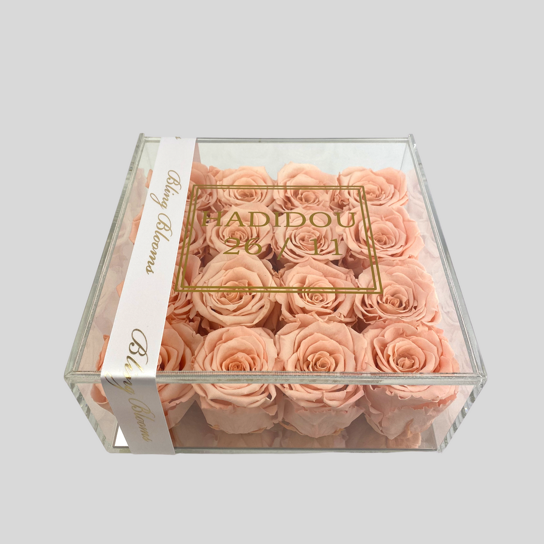 Infinity Rose Acrylic Frame | 16 Perfect Peach Roses in a clear box with mirrored base | Bling Blooms