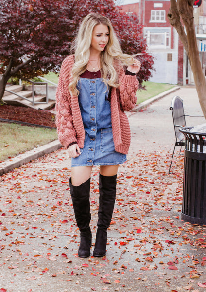 how to style a denim overall dress with a cardigan for the winter