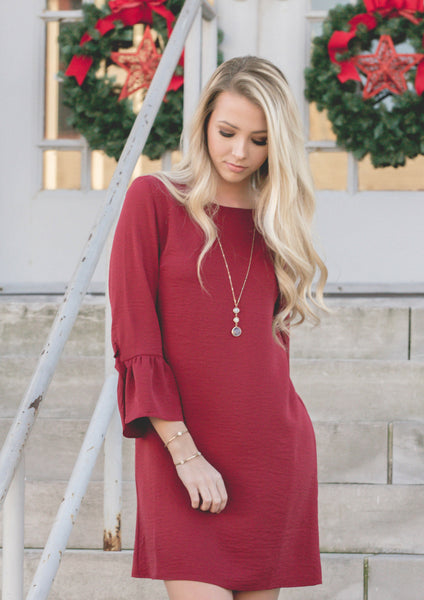how to style a red wine dress for a christmas outfit