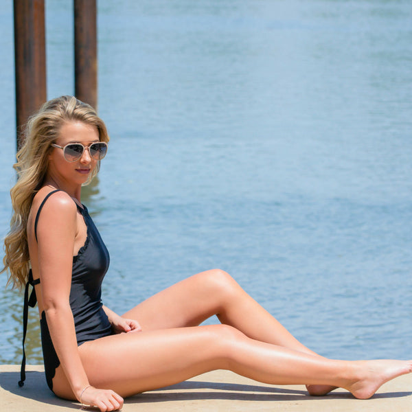 how to style black scalloped one-piece swimsuit
