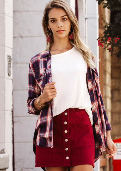 shop siloe features how to style an outfit from summer to fall with a plan top and red skirt for a fall outfit