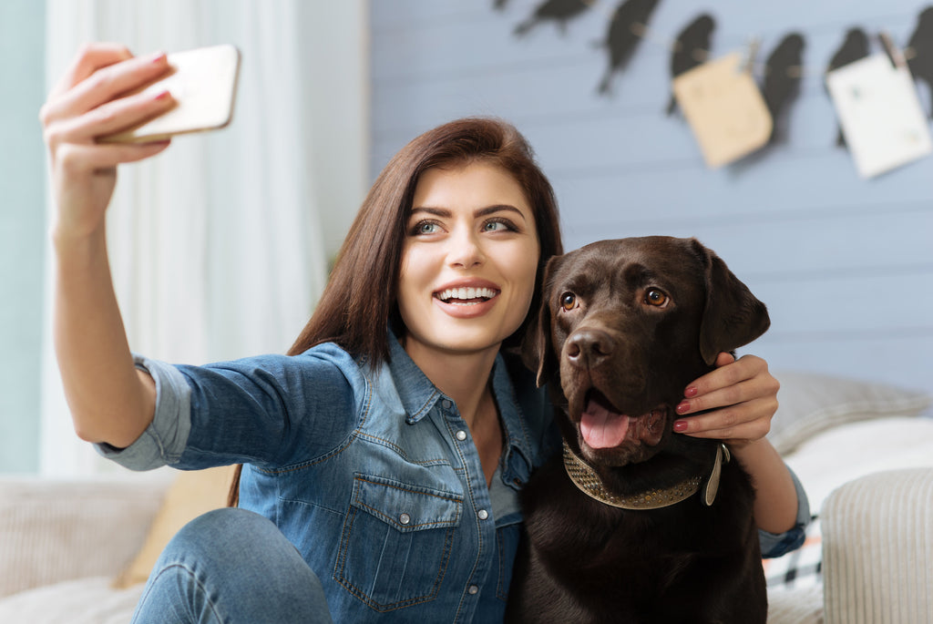Lady Taking Photo With Her Dog