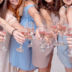 Alt Image Tag: An image of a bunch of women cheersing.