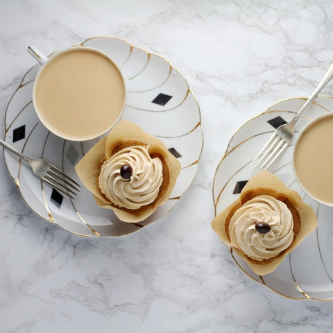 two coffee and coffee cakes on posh saucers
