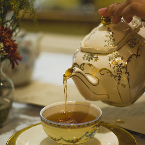 tea being poured out of a fancy teapot