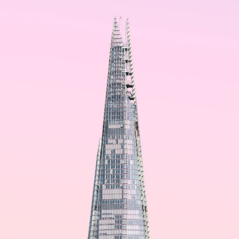 the top of the shard on a baby pink background