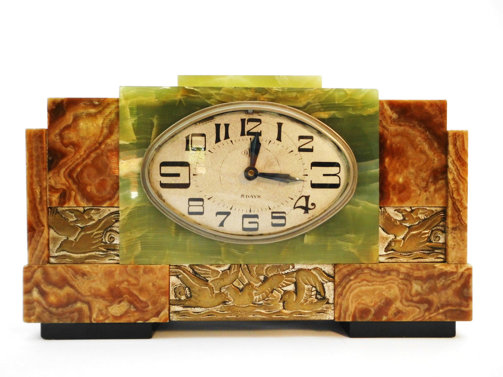 Exceptional French Art Deco marble 8-days Clock with green Onyx and Bronze Bas Relief plaques of Seagulls. 1920s. Currently fitted with a quartz movement.