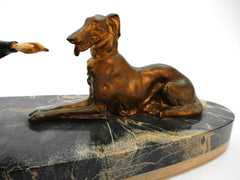 "Medium sized ""Chryselephantine"" lady with Borzoi (Russian wolfhound), mounted on a Portoro marble base by Scali, France 1930s. Spelter and Ivoreen. Overall length 49 cm  19.30""."