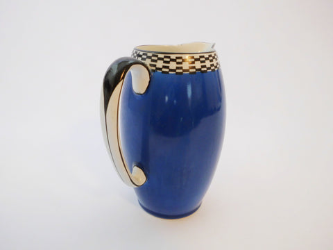 Blue Pitcher with Black & White Checkered pattern