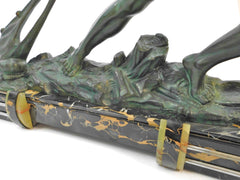 Impressive Art Deco Sculpture by Alexandre Ouline France/Belgium 1920s. Cold Painted Metal Sculpture on a Stunning base of Portoro Marble with Green Onyx Accents.