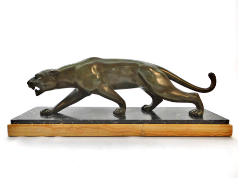 Elegant, stylish Bronze Panther by Salvatore Melani (Italy1902-1934). Massive green patinated Bronze. Mounted on a Base with 2 kinds of Marble. France 1920s.