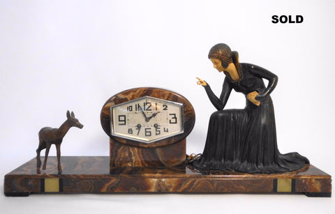 Art Deco Clock  approx. 1935 France  signed D. COSTAN  spelter and Ivorine figure group