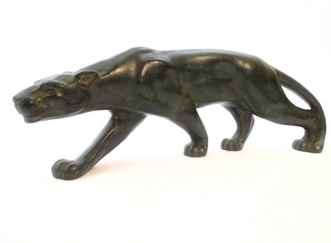 Elegant crouching Panther ready to strike, created by Secondo in France around 1930. Bronze, finished with a green patina.