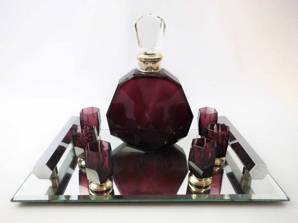 Crystal amethyst Decanter & six Glasses set Val St. Lambert Belgium, model Nungesser 1927. Presented on a Mirror bottomed Tray with two handles.
