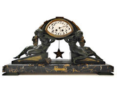 "Impressive Clock in green patinated Spelter on a Portoro Marble Base. Designed by the famous Belgian Sculptor Georges Van de Voorde. This Masterpiece named ""L'Etoile"" (Star) was presented at the select ""Salon des Artistes Français"" in Paris around 1920."