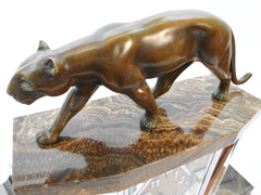 Bronze Panther Clock Set by Michel Decoux, France around 1910. Art Deco Cubist French Clock set with a 6 side Glass Clock case, mounted on a brown marble base with stepped chrome tubing.