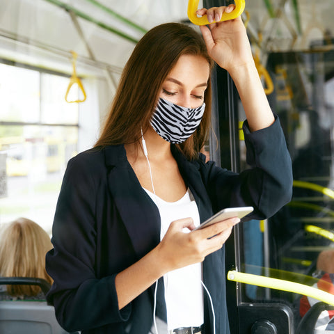 woman in zebra mask on train