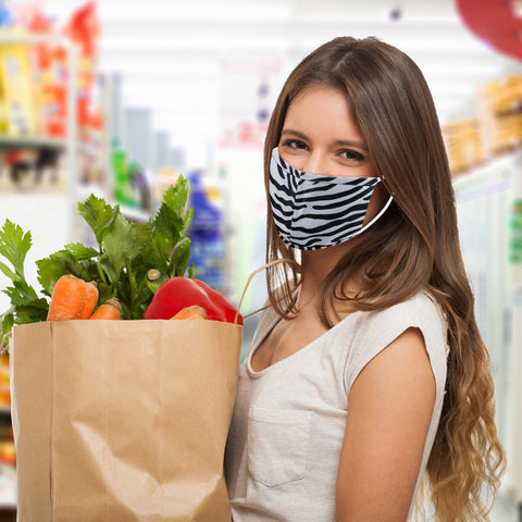 woman in zebra face mask with groceries