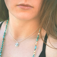 Load image into Gallery viewer, Sterling silver artisan charm on a woman's neck. Has a very boho and casual vibe.