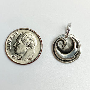 Each sterling silver, wax seal, charm is individually handmade. a true one of a kind piece. They sometimes differ but usually a similar size to an American .10 cent dime.