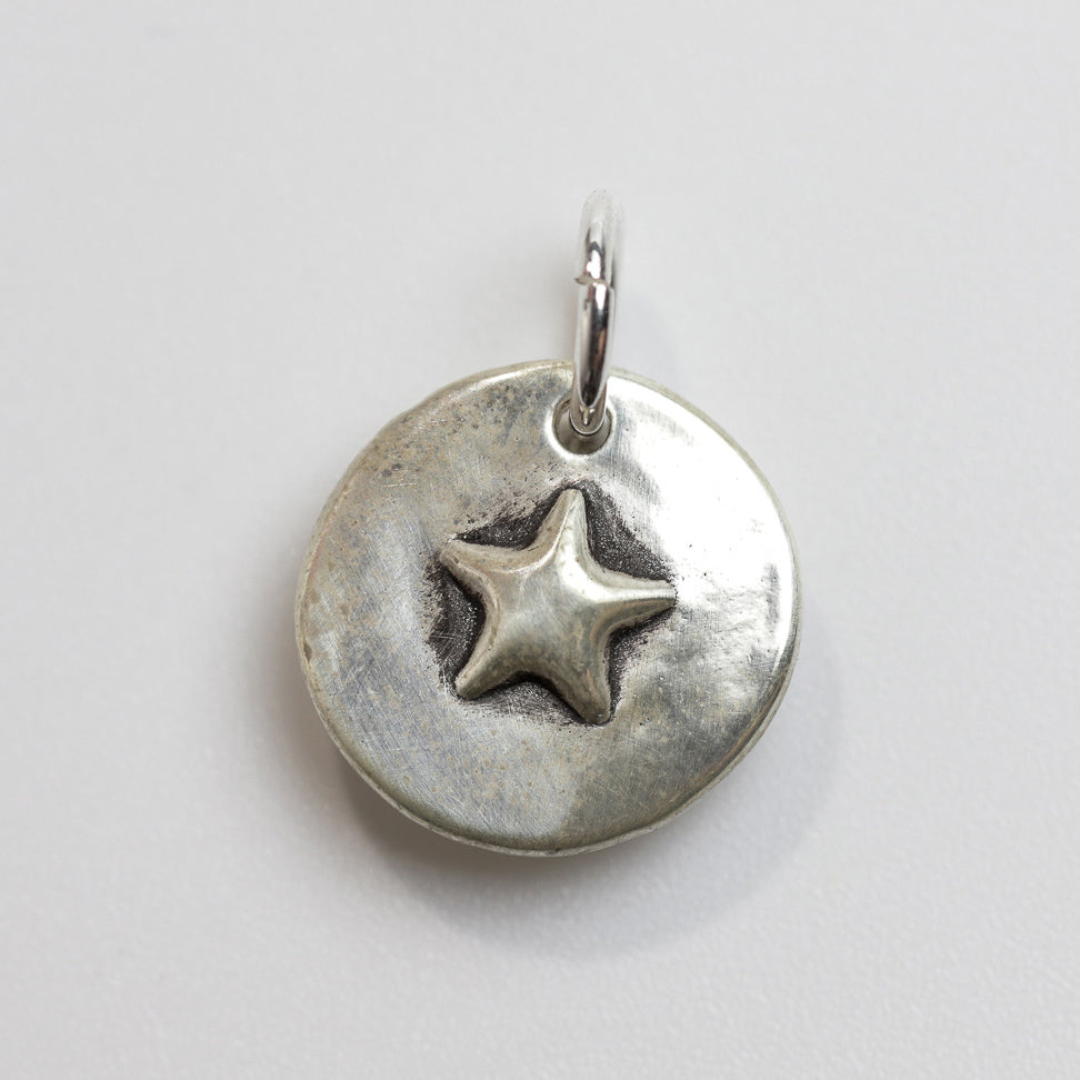 EMPTY SKIES Sterling Silver Star Charm