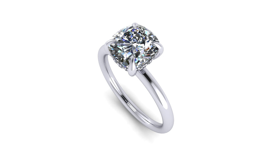 Cushion-Cut Center Stone with Diamond Hidden Halo Engagement Setting  This ring features a square cushion brilliant center stone set in an all-around comfort fit rounded solitaire shank with a diamond basket that elegantly cradles the center stone.