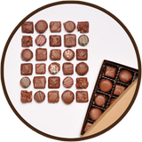 Assortment of handmade milk chocolates in a large gift collection. Made in Kalona, Iowa.