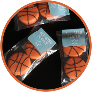 Oreo cookies covered in chocolate and hand decorated as basketballs athletics and sports