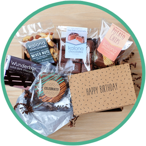 Birthday chocolate gift boxes include a birthday card and handmade chocolates from Kalona, Iowa.