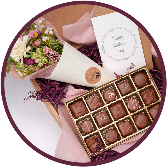 A handmade chocolate collection and flowers gift box for mothers day.