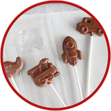 Chocolate kid gifts are so cute! We make airplanes, trains, rockets, trucks, and tractor chocolate lollipops.