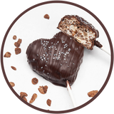 Dark chocolate cocoa krispy treat lollipop, shaped like a heart.