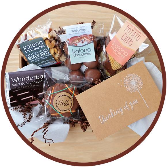 The small Just Because gift box includes a thinking of you card and handmade chocolates from Kalona, Iowa.
