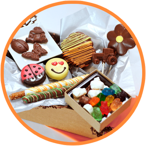 These chocolate gift boxes are made just for kids! They includes fun chocolates that any child will enjoy and are handmade in Kalona Iowa.